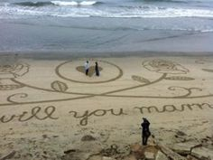 Marriage proposal in the sand at Huntington Beach, CA, created by Santa Monica artist Andreas Hoenigschmid. Beach Proposal, Prom Proposal, Romantic Proposal, Wedding Proposals, Marriage Proposals, Beach Photos, Cute Photos, Proposal Pictures, Proposal Ideas