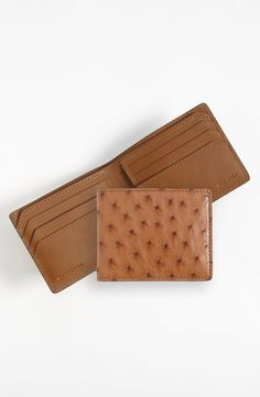 Free shipping and returns on Burberry Ostrich Leather Wallet at Nordstrom.com. Ostrich leather with natural whorls composes an exquisite, Italian-crafted wallet.
