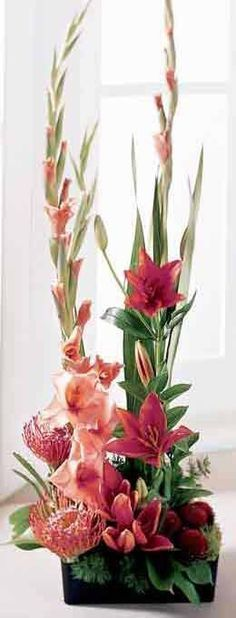 I can see this with 2 gladiolas - tall pink floral arrangement Tropical Flowers, Tropical Flower Arrangements, Church Flower Arrangements, Church Flowers, Beautiful Flower Arrangements, Funeral Flowers, Exotic Flowers, Flower Centerpieces, Flower Decorations