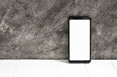 Smart phone with white display screen on white table against concrete wall Free Photo Vertical Business Cards, Business Card Psd, Signage Board, Cover Pics For Facebook, Quran Wallpaper, Youtube Design, Youtube Banners, Sale Banner, Concrete Wall