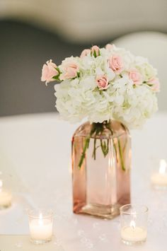 simple white and pink hydrangea centerpiece with candles