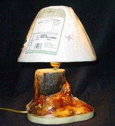 A small lamp made from a large pine tree where the branch came out of the side.