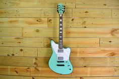 Robbie designed this Zuma with a pearlescent seafoam finish and a set of Moniker humbuckers.  Design your custom guitar at https://monikerguitars.com.