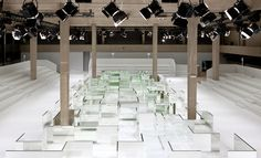 Dior Homme The Villa Eugénie team dressed the large show space at the Tennis Club de Paris in white, with a mirrored labyrinth guiding the models' path. The reflections played with Kris Van Assche's perfectly executed geometric minimalism.