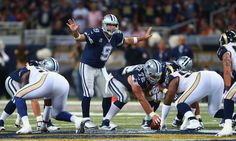 ST. LOUIS, MO - SEPTEMBER 21: Tony Romo #9 of the Dallas Cowboys singles at the line of scrimmage during the third quarter against the St. Louis Rams at the Edward Jones Dome on September 21, 2014 in St. Louis, Missouri.  The Cowboys beat the Rams 34-31.  (Photo by Dilip Vishwanat/Getty Images)