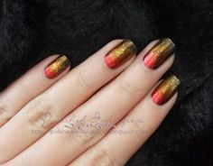 I am obsessed with Hunger Games, the girl on fire inspired nails.