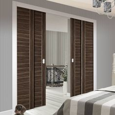 Deanta Quad Telescopic Pocket Kensington Oak Doors Clear
