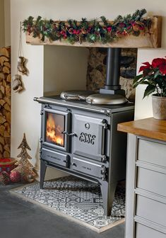 The Ironheart multifuel cooker warms the room too.,Wood burning ESSE Ironheart cook stove, perfect for warming your guests ready for a rustic cooked dinner. What is wood burning ? Wood Burning Cook Stove, Wood Stove Cooking, Wood Burning Stoves, Wood Burner Fireplace, Fireplace Hearth, Wood Burning Fireplaces, Wood Stove Hearth, Fireplace Tiles, Fireplace Kitchen