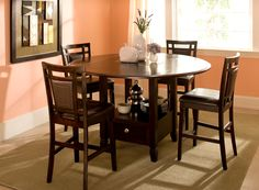 Can't decide if you need a square or round table? Then get the best of both worlds with this Northfield 5-piece counter-height dining set!