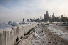 Ice builds up along Lake Michigan at North Avenue Beach as temperatures dipped well below zero on January 6, 2014 in Chicago, Illinois. Chicago hit a record low of -16 degree Fahrenheit (-27C) as a polar air mass brought the coldest temperatures in about two decades into the city