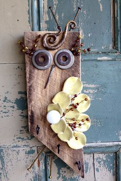 A personal favorite from my Etsy shop https://www.etsy.com/listing/268643749/rustic-upcycled-owl-wall-hanging-with