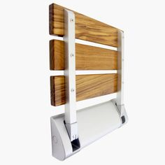 "MPN:CRS501101 Add convenience and bring the comfort of a spa to your shower with the 12"" Burmese Teak Wood Modern Folding Shower Bench. Including premium hardware finishes and finished teak wood, this"