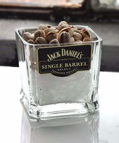 Fun DIY Ideas Made With Jack Daniels - Recipes, Projects and Crafts With The Bottle, Everything From Lamps and Decorations to Fudge and Cupcakes |  Jack Daniels Single Barrel Nuts or Candy Dish Cut Bottle Idea |   http://diyjoy.com/diy-projects-jack-daniels