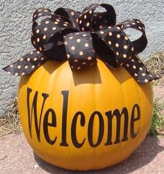 Great way to add a touch of Fall to your porch! #FallPumpkinDecor #PorchWelcome