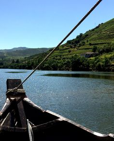 """While in Porto, take a cruise all the way up into the Douro Valley where lush, green vineyards are nurtured along either side of the glistening water. Disembark in one of the nearby towns of Peso de Regua or Pinhao to tour one of the quintas nestled in the hilltops."""