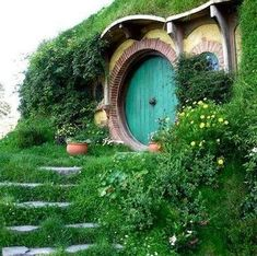 Hobbit Houses ~ click on photo to see 14 very unusual homes hobbit style utilizing the earth for their construction.