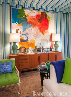 In a bright, glamorous room, a large scale, colorful painting is a perfect fit over the sideboard. - Photo: Peter Rymwid / Design: Gary McBournie