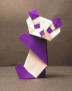 Panda origami (Instructions here :http://perfectpandas.com/wp-content/uploads/2007/11/purple-panda-origami.pdf) http://www.origamiway.com/origami-panda.shtml