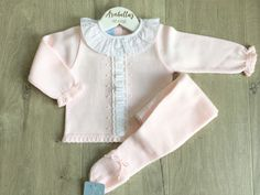f79e3bfcb Arabella's Baby Boutique Granlei baby pink knitted suit with frill neck and  satin ribbon detail.