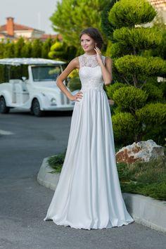 647be9096fa2 Luxusné svadobné šaty so saténovou sukňou a čipkou zdobeným vrškom Svadobné  Šaty