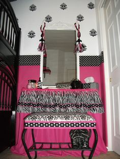 more of the zebra stuff....she stapled fabric to the bottom of a shelf and hot glued fringe around it for a vanity.