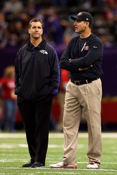 NEW ORLEANS, LA - FEBRUARY 03:  Head coach John Harbaugh of the Baltimore Ravens (L) and head coach Jim Harbaugh of the San Francisco 49ers speak during warm ups prior to Super Bowl XLVII at the Mercedes-Benz Superdome on February 3, 2013 in New Orleans, Louisiana.  (Photo by Mike Ehrmann/Getty Images)