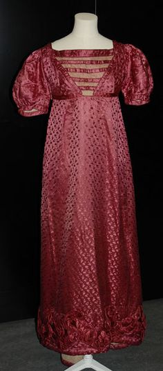 The color of this 1820's gown is puce, which is actually much prettier than it sounds--kind of a pinkish red--and was a very popular choice for fashion and design during the Regency and late-Georgian period.