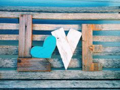 Sexy reclaimed wood love letters! These rustic letters are chunky and pieced together from pieces of discarded wood and given new life to