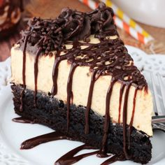 Pumpkin Chocolate Brownie Cheesecake - a moist and chewy brownie topped with no bake pumpkin cheesecake! To die for!