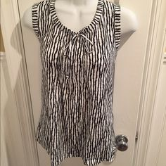 "Merona black & white top Tie at the neck. Sleeveless and about 25"" long. Merona Tops"