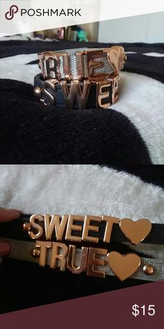 """Cute BCBG faux leather and nylon bracelets Super cute! See pics for wear. All buttons working condition! One gray says """" true"""" One black says """"sweet"""" Brand: bcbg Price is for both!;) BCBG Jewelry Bracelets"""