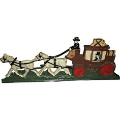 Here is a vintage, painted, cast-iron, horse drawn carriage door stop.  Shows a man and woman inside carriage with luggage tied down to the top and