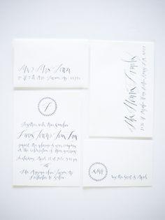 Black And White Wedding Invitations Ideas Calligraphy Betsy Dunlap. I love the little circle monogram motifs.
