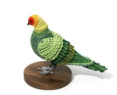 Laurel Roth Hope, Carolina Parakeet, 2009, crocheted yarn, hand carved pigeon mannequin, walnut stand, 8 x 9 x 13 inches.