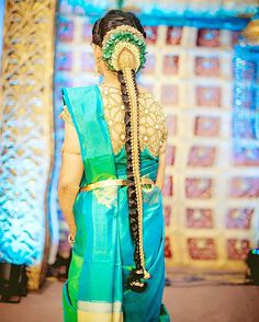 South Indian bride. Gold Indian bridal jewelry.Temple jewelry. Jhumkis. Blue silk kanchipuram sari.Braid with fresh jasmine flowers. Tamil bride. Telugu bride. Kannada bride. Hindu bride. Malayalee bride.Kerala bride.South Indian wedding.