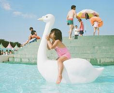 Japanese Photographer's Daughter 'Puckers Up' In Series Of Adorable Photos - DesignTAXI.com