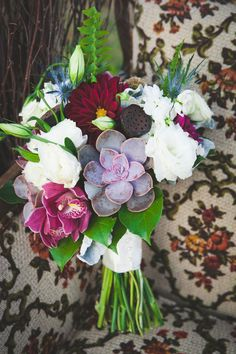 Eclectic bridal flowers from a fall wedding in magenta,cream and purple.