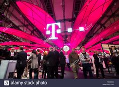 Hannover, Germany, 20th March 2017 - CeBIT digital technology trade fair, trade fair visitors at geutsche Telekom's booth Stock Photo