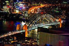 The Sydney Harbour Bridge from the Sydney Eye.  #sydneyharbourbridge #sydneytowereye #elevation #Sydney #Australia #lights #city #urban #dense #street #gold #view #305mfromtheground #NightLife #night #reflection #8tillnewyear #HashtagsAreSuperfluous by utkarshclicks http://ift.tt/1NRMbNv
