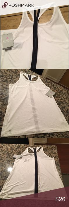 Athleta White Tank, with tags Super cute detail down back, perfect condition, with tags, never worn Athleta Tops Tank Tops