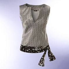 Blusa con cinto Instructions, in Spanish, for this ultra-cute top. I love the combination she's Blouse Patterns, Clothing Patterns, Sewing Blouses, Diy Kleidung, Diy Vetement, Shirt Bluse, Couture Sewing, Couture Tops, Diy Clothing