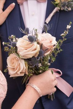 Blush roses with blue thistle prom bouquet Prom Bouquet, Prom Corsage And Boutonniere, Red Bouquet Wedding, Blush Bouquet, Blush Roses, Bride Bouquets, Boutonnieres, Homecoming Flowers, Prom Flowers