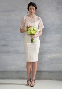With the ceremony chiming behind you, you sashay with a smile in this ivory midi. Making your way to the reception clad in the simply sweet and side-ruched sheath dress that sits beneath an ornately detailed lace top, you can't help but revel in the sounds of this most romantic occasion!