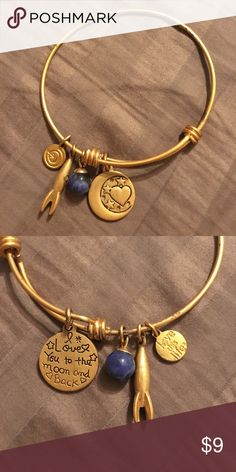 """I love you to the moon and back"" charmed bangle Gold color bangle with cute little charms with one that says ""I love you to the moon and back"" very cute, never worn. I have tiny wrists so it doesn't fit me well. Looks like the gold color has flaked off in a few places but is hardly noticeable 👍🏼 Jewelry Bracelets"