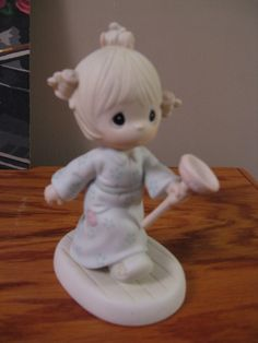 Precious Moments Figurine in TnT's Garage Sale in Omaha , NE for $10.00. Have just outgrown these.