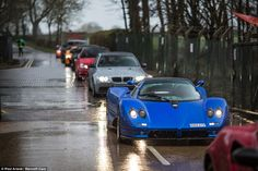 Striking: A vivid blue Pagani Zonda S Roadster, one of only eight right hand drive models ever made, brightens up a dull day in the countryside