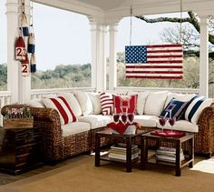 American Country; This is an example of American Country design. The room is very patriotic and includes an American Flag, that looks like it was once wood painted into a flag.