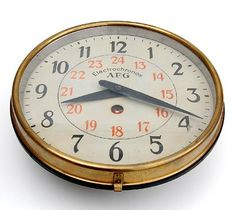 Wallclock Elektrochronos painted metal case with brass rim design Peter Behrens executed by AEG Germany 1907-'14