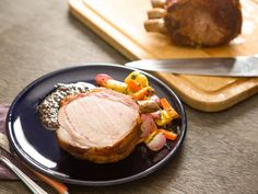 A bone-in pork loin roast is one of those cuts that's guaranteed to impress. The best part is that it's also dead easy to cook just right, as long as you use the reverse-sear method: Cook it low and slow until it's perfectly done throughout, then crank the heat to brown the exterior. Here it's rubbed with a smoky spice mix, then served with roasted root vegetables and an olive tapenade sauce.