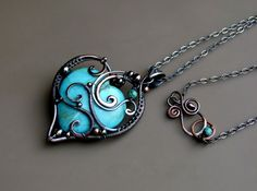 "This pendant was made from fine silver wire, copper wire and adorned with natural turquoise stones, sterling silver beads and copper beads, oxidized for an antique look, polished and treated with a sealer to stabilize the oxidation and preserve the color of the metals. They were wire wrapped, hammered and polished at every step. Pendant length: 6 cm / 2.5"" Necklace length: 20"""